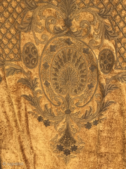 """19th C. Chenille Portiere  Burnished gold colored chenille embroidery with bottom end oval and fan (14"""" W x 17""""L) with floral stems and a floral bouquet at top (24"""" W x 43"""" L).  ..."""
