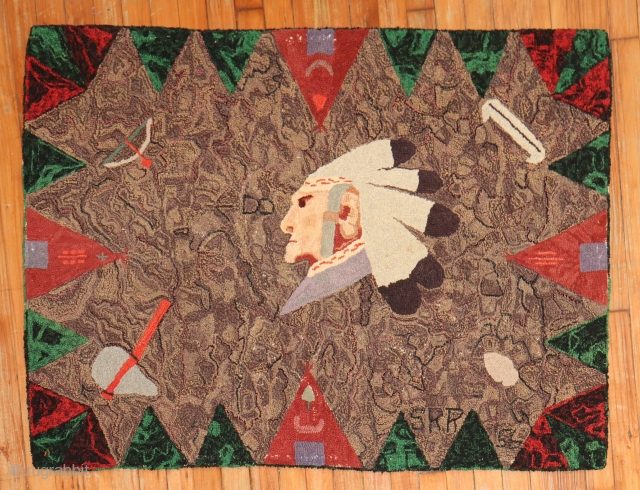 DAted American Hooked rug.  Native american Cheif in center with lovely highlights.  3'x4'..  Dated 1956?