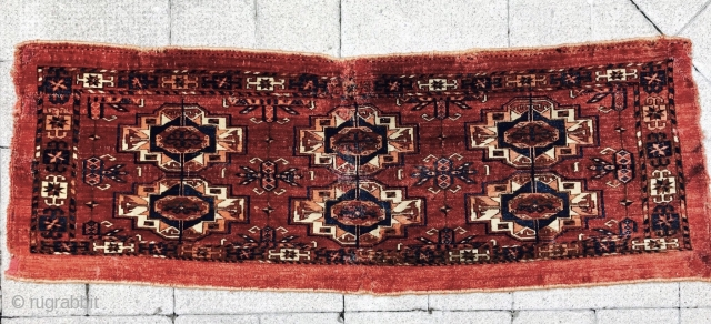 Tekke Torba with an interesting orange colour used in the gul quarters. 127cms x 44cms.