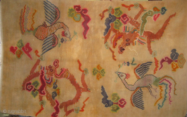 Early 20th century ivory Tibetan rug with dragons and phoenix in mint condition measuring 7.5 x 4.8 ft.