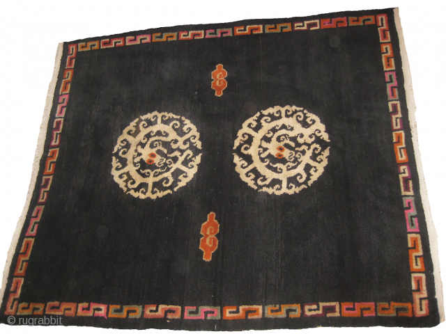 An old Key Dragon rug in mint condition, measuring 167 x 152 cm.