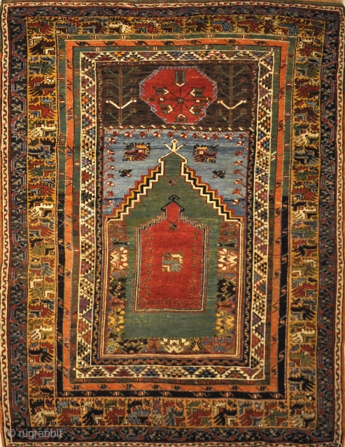 This Mudjur Meditation Prayer Rug has the richest palette of all Anatolian rugs, and resemble the very fine Caucasian rugs. Patterns and motifs are strictly geometrical.