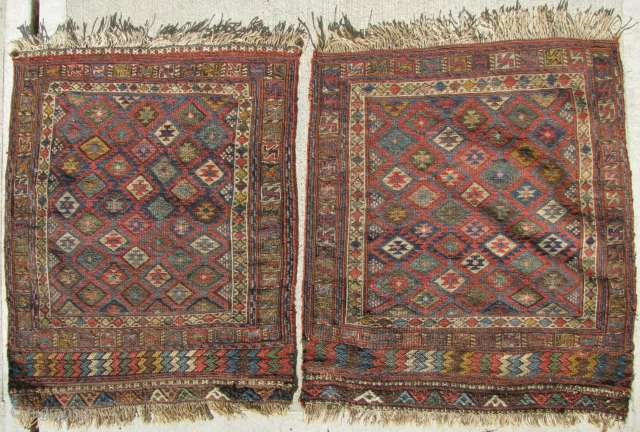 A pair of antique Persian Kurd Soumac Bagfaces.  In excellent condition and with great dyes.  Reds are vegetal and not