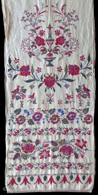"Rushnyk. Ukraine, 1st half 20th century. 105""x17"" selvedge to selvedge (both selvedges intact). The rushnyk is shown folded in half - the same pattern appears at the top and bottom. The embroidered  ..."