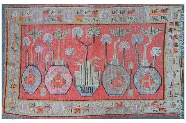East Turkestan Carpet (possibly a Yarkhand), a Chinese art deco version from the 1920ties, 238 x 141 cm, losses on the right border side.