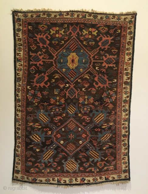 Kuba bird rug. 1st half 19th Century.  Two medallions on purple brown field, radiating birds with Marasali type striping.  Note three Seychour cabbage heads floating below upper medallion. Attractive floral  ...