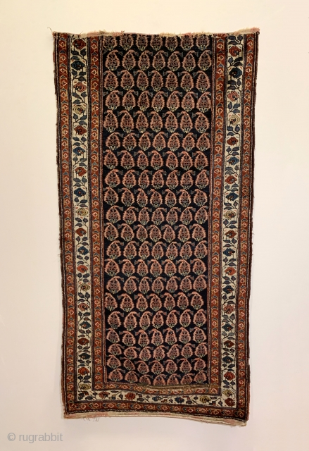 Antique Persian Kurdish Runner. Circa 1910. Alternating rows of glowing boteh sit on a soft-silky indigo field. The boteh drawing and spacing is random suggesting it was woven in a tribal environment.  ...