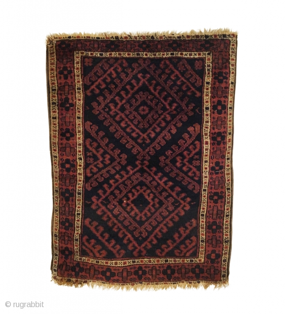 Antique Jaf Kurd Small Rug. Late 19th Century. Radiating latch hook diamonds on purple brown field. Very good condition. Minor losses to top and bottom. 5 colors. 2'4 x 3'2. Carefully hand  ...