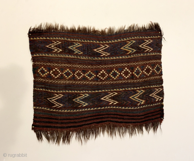 """Antique Uzbek Kilim Bagface. Rare size. Horsehair foundation. Rows of alternating colored chevrons and stepped diamonds. Truly tribal, original condition. 6 colors. 1'9"""" x 2'3"""". Professionally hand washed."""