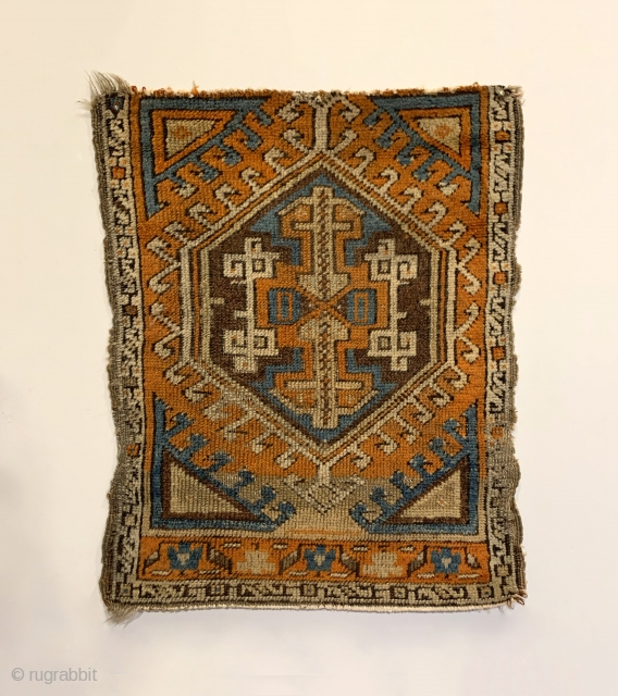 Early Yastik Fragment. Central Anatolia. 2nd Half 19th Century. Abrashed field with saturated colors including strong purple and turquoise. Compare the rendering of center medallion arrows and joined ivory hooks to plates  ...