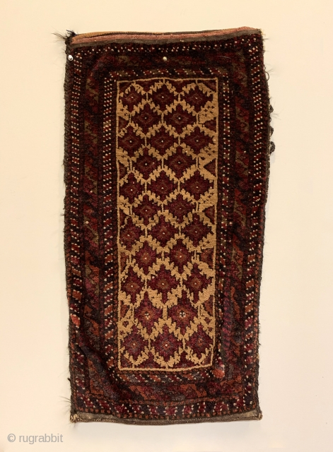 "Antique Baluchi Tribal Cushion (Balisht). Northeast Persia. Stepped purple pendants on camel field. Full pile in original condition. 5 colors. 2'7"" x 1'4"". Delicately hand washed.