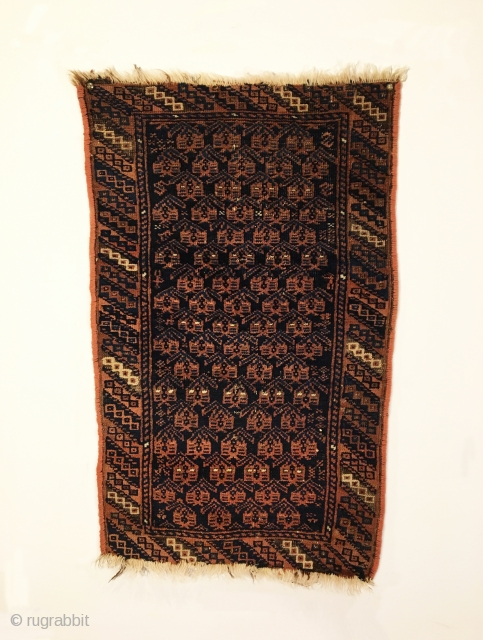 """Antique Timuri Baluch Balisht. Circa 1900. Botehs sit on dark blue field. Great condition. Finely woven and reselvaged. 7 colors. 2'7"""" x 1'7"""". Delicately hand washed."""