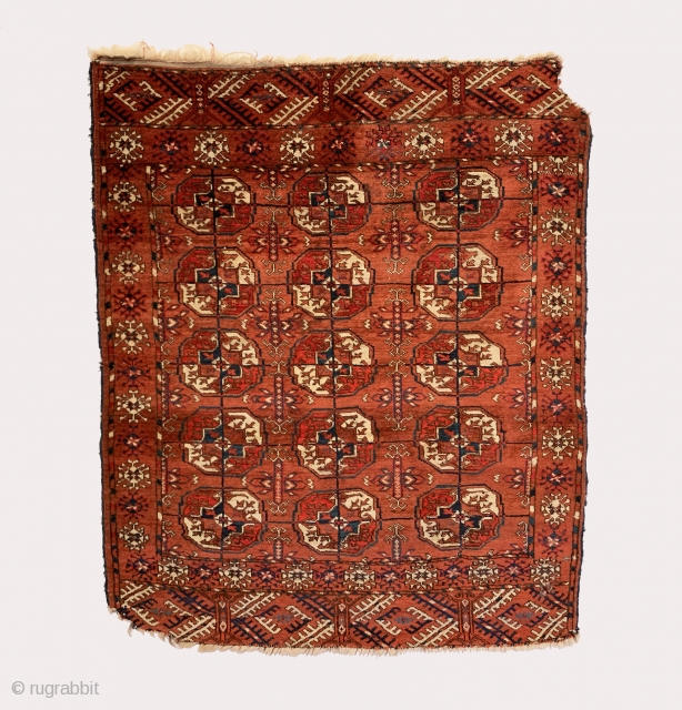 Antique Tekke Small Rug. 4th Quarter 19th Century. Small collectible piece. 15 central gul medallions sit on saturated brick red field framed by stylized geometric alternative indigo and ivory border design. Original  ...