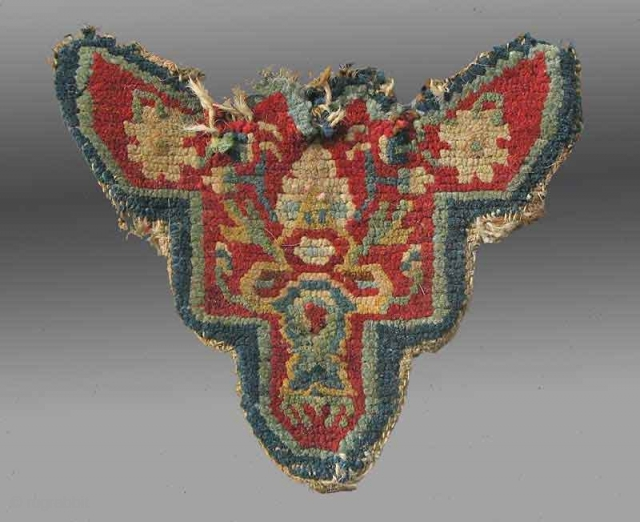 """Animal Trapping, Tibet, late 19th c., 1' x 10""""  Such animal trappings were used by the lead animal in a caravan, often placed on the forehead of the mule or horse in the  ..."""