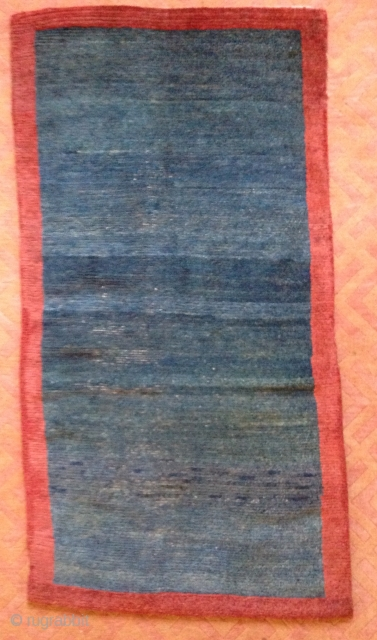 Khaden. Open field green/indigo sleeping carpet.  Field and border repairs. Some low pile 31 x 59 inches 19th Century Tibet