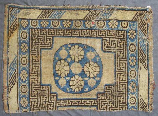 "Khotan Oasis, East Turkestan, 4. Quarter 19th. century, 119 x 83 cm, 3'11"" x 2'8"" ,   https://wildcarpets.com"