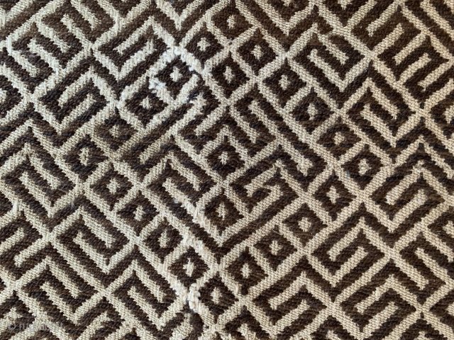An unusual embroidery of yak wool with an allover pattern reminiscent of a labyrinth. Four panels have been sewn together as a basic fabric, which ties in with the Tsuktruk tradition. Maybe  ...