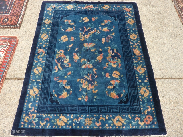 """Beautiful antique rug69"""" x 53"""" full even pile pile with some unfortunate moth damage (see pictures)."""