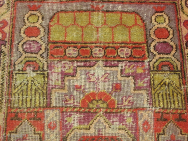 Antique Khotan prayer rug early 20th century . four crecents at the corners. mosque desing in the centre. worn at some places. size 2' x4'. Any offers welcome regarding price. Free worldwide shipping.