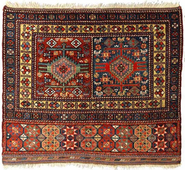 An exquisite Kurdish pile-woven mafrash 'panel' (or 'bag-face') - from the far North West of Persia (Iran) or the far southern Caucasus - with a double medallion design in the center with  ...