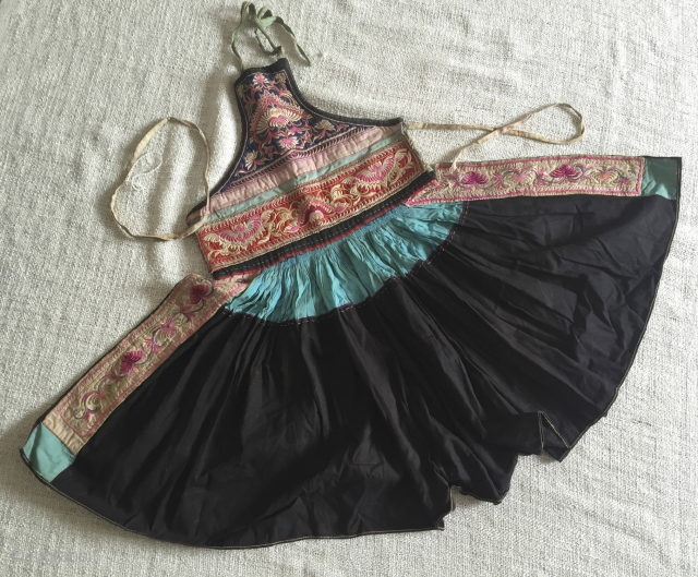 Child's Apron Tunic - Ethnic minority China. The wide flair of the skirt segment (119cm), created by dozens of tiny close pleats, is similar to the flower skirt of the Miao people.  ...