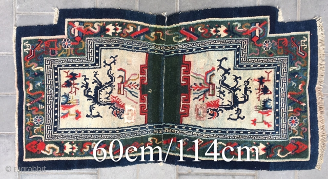 Tibetan horse saddle rug, rare green background with double dragon pattern, Buddha eight treasure selvage. About 80years old.