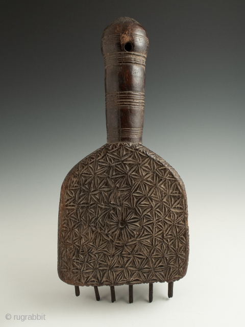 "Large weaving comb from India in carved wood and with iron tines. 12.5"" (31.7 cm) high by 5.75"" (14.6 cm) wide, early 20th century. Ex. Cathryn Cootner, Sonoma."