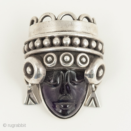 """Aztec head brooch or pin, Talleres de los Ballesteros, Taxco, Mexico. Silver, amethyst, Mid-20th century. 1.75"""" (4.5 cm) high. A beautifully carved amethyst head of Aztec royalty set into a sterling silver  ..."""