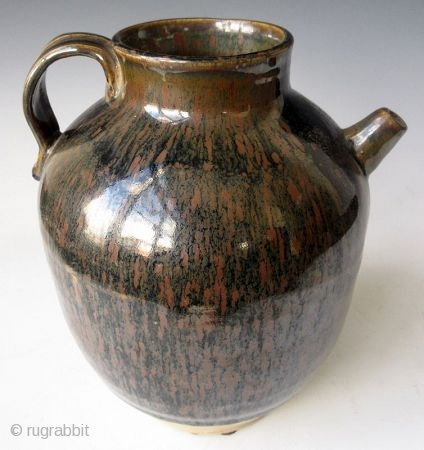 Antique Japanese Tenmoku Ware Handled Vessel   Japanese tenmoku ware ceramic vessel with ribbed handle, short front spout, and wide open top. The thick oil slick glaze stops just short above the foot left  ...