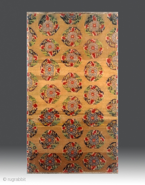 """No.M87 * Tibetan Antique""""Medallion"""" Rug .Size: 95x163cm(3'1""""x5'4""""). Origin: Tibetan.Shape: Rectangle. Background Color: Yellows .wool/wool.This Tibetan carpet is a beautiful traditional medallion rug. The multi-colored medallions have designs based upon geometrically stylized flowers.  ..."""