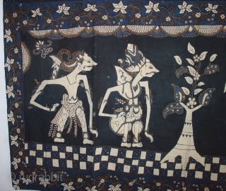 Handsome Wayang Batik from Java: Circa 1925. Good condition with a couple of small holes and light fading on one side. Deep indigo.