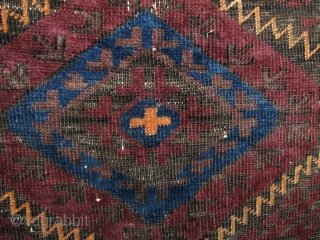 Pretty all wool, Baluchi (best guess- if I'm wrong feel free to correct me) 19th century rug. Intense blue dye and very supple. There are a couple of small tears (broken weft  ...