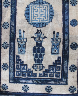 Chinese Baotou rug with classic scholar's motif. This is circa early 20th century, there has been extensive old reweaving done on this as can be noted a beige toned areas on the  ...