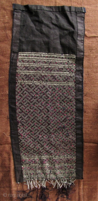 Rare jacket back panel from the remote Miao Jiupang group from Jiahe County, Guizhou province (see last enlargement), with purple embroidered pattern between the spaces in the tin decoration. This style of  ...