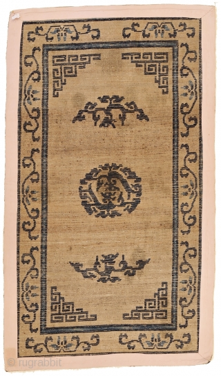Tibetan Khaden with archaic dragons  Circa 1900 158 x 91 cm (62 x 36 in.)   Knot count:9 H x 6 V = 54 kpsi Colours:dark blue, medium blue, light blue, camel (4) Condition:excellent. Full pile  ...