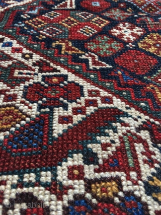 Khamseh bird rug with unusual peacock motif and gorgeous light blue. Overall good condition. Beautiful colors and drawing. Professionally hand washed. 19th century. Overall lowered pile. Dog eared corner, top some rows  ...