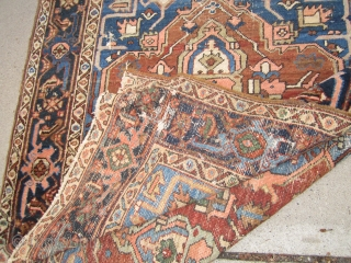"""antique serapi heriz rug measuring 4' 11"""" x 6' 2"""" condition as shown one hole area of wear and scattered moth issue generally a good pile has been cleaned ends need work  ..."""