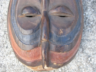 Vantage African mask, hand carved wood, Luba People, D R Congo, white, blue, red, dings and scuffs, loss of paint, hair line cracks but stable, it represents either facial painting or ritual  ...