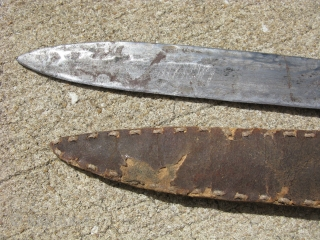 Antique Native American knife, hand forged metal blade, hand made hide handle on wood, and hide sheath both sewn with sinew, although repurposed as a knife, the blade may have started life  ...