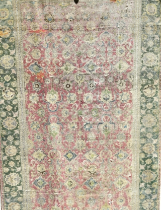 Indo-Isfahan Carpet, second half of the 17th century. Worn and with several generations of scattered repairs but complete. Apx. 8'x18'