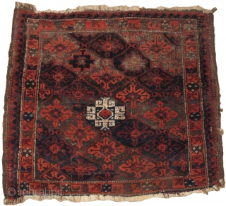 """Baluch bagface with a solitary white Memling gul, mixed snow-flakes and Memlings in a lattice. Fantastic Baluchi wool. All natural dyes with an abrash using a double-dyed slate-blue/ purple. 28""""X24"""""""