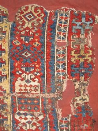 East Anatolian Kurdish rug fragment. Super vibrant madder. mounted and conserved.