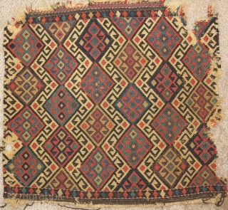 Northwest Persian flatwoven bag. Probably Kurdish. Not quite ' reverse sumak '. One side is flat while the other is more textured. Great colors including aubergine. Maybe Shahsevan Kurd?