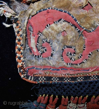 Central Asian, most likely Kirghiz, leather and felt.  Not sure what this is, but most likely an animal trapping, perhaps a decorated pad for saddle or harness.  The face is  ...