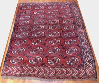 It's a MAD MAD (Middle Amu Darya) carpet fragment (missing main and outer guard borders at left, minimal loss on other three sides).  Good age, all natural colors with wonderful abrash  ...