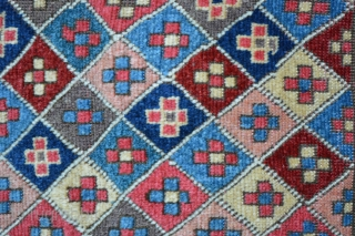 """A pair of rare, early 19th century knotted-pile Shahsevan bag-faces with superb saturated natural dyes and soft wool. 53cm x 50cm (1' 9"""" x 1' 8"""")."""
