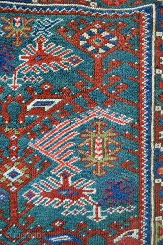 Bergama rug with beautiful green/turquoise field in good overall evenly-low pile.
