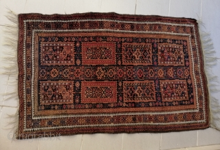 A fine antique truly tribal Timuri Baluch rug with an unusual central axis of small mihrab-like motifs, early 20th c. Well preserved and for a nice price.