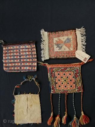 Three tribal vanity bags (Kurdish, Qashqāï and Shāhsavan) and one Baluch mini rug.