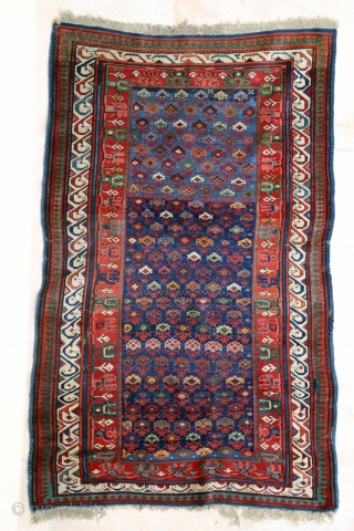 Antique Caucasian Seychour, ca 1870. 111 x 179 cm ,Original selvages and upper end, some fraying to lower end. Some spots of low pile. Corroded black. Excellent colours.